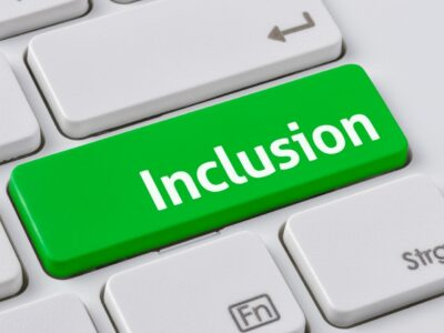 A green button on a keyboard that says 'inclusion'
