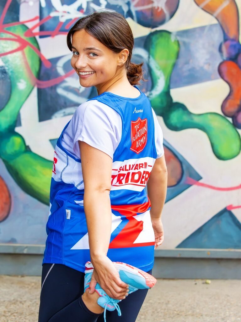 Photo of Ruxandra Porojnicu in running gear smiling